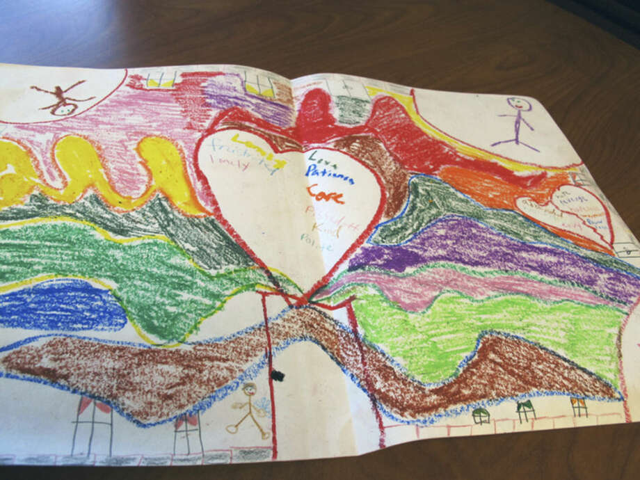 In this July 16, 2014 photo, a picture that Rhonda Bailey, 48, drew as part of her art therapy at the Minnesota Sex Offender Program in St. Peter, Minn. is displayed. Bailey is the only female who has been civilly committed to the program that houses the state's most dangerous sexual predators. Experts evaluating the program recently recommended that she be moved, but the state says there is currently no other option for her. (AP Photo/Amy Forliti)