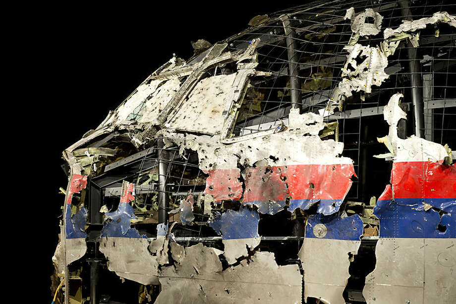 The reconstructed cockpit of Malaysia Airlines Flight 17 plane is seen prior to the presentation of the Dutch Safety Board presents the board's final report into what caused Malaysia Airlines Flight 17 to break up high over Eastern Ukraine last year, killing all 298 people on board, during a press conference in Gilze-Rijen, central Netherlands, Tuesday, Oct. 13, 2015. (AP Photo/Peter Dejong)