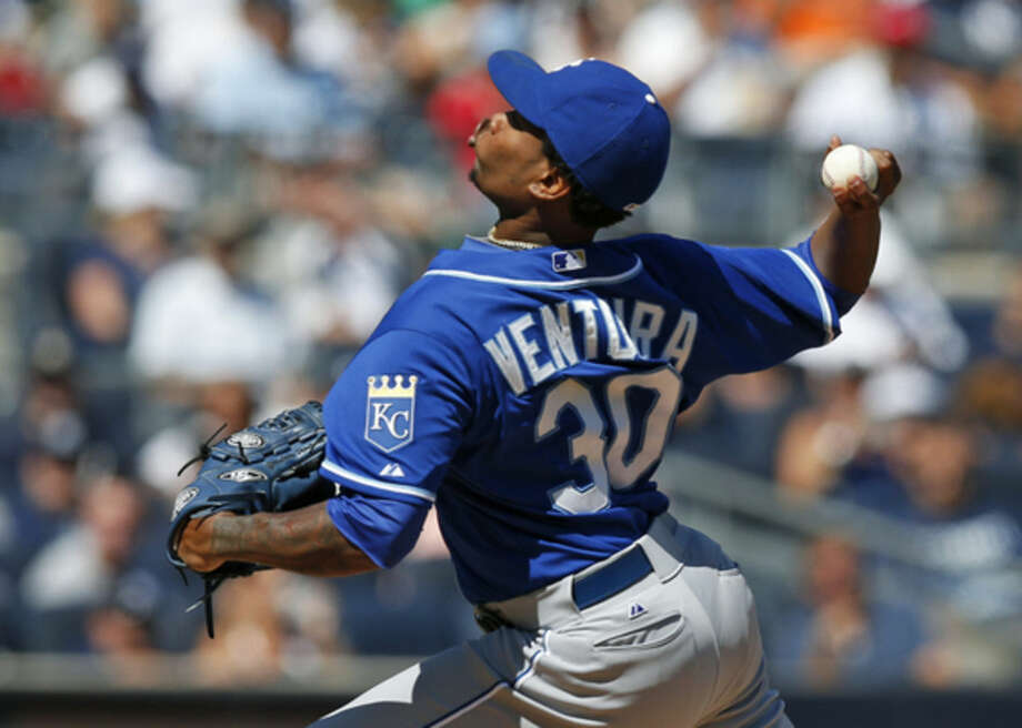 Kansas City Royals starting pitcher Yordano Ventura (30) delivers in the first inning of a baseball game against the New York Yankees at Yankee Stadium in New York, Sunday, Sept. 7, 2014. (AP Photo/Kathy Willens)