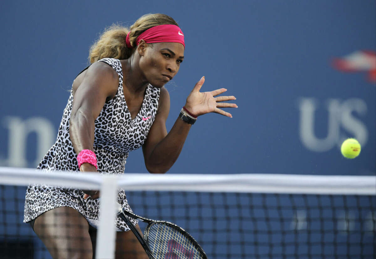 Serena Williams, returns a shot against Caroline Wozniacki, of Denmark, during the championship match of the 2014 U.S. Open tennis tournament, Sunday, Sept. 7, 2014, in New York. (AP Photo/Charles Krupa)