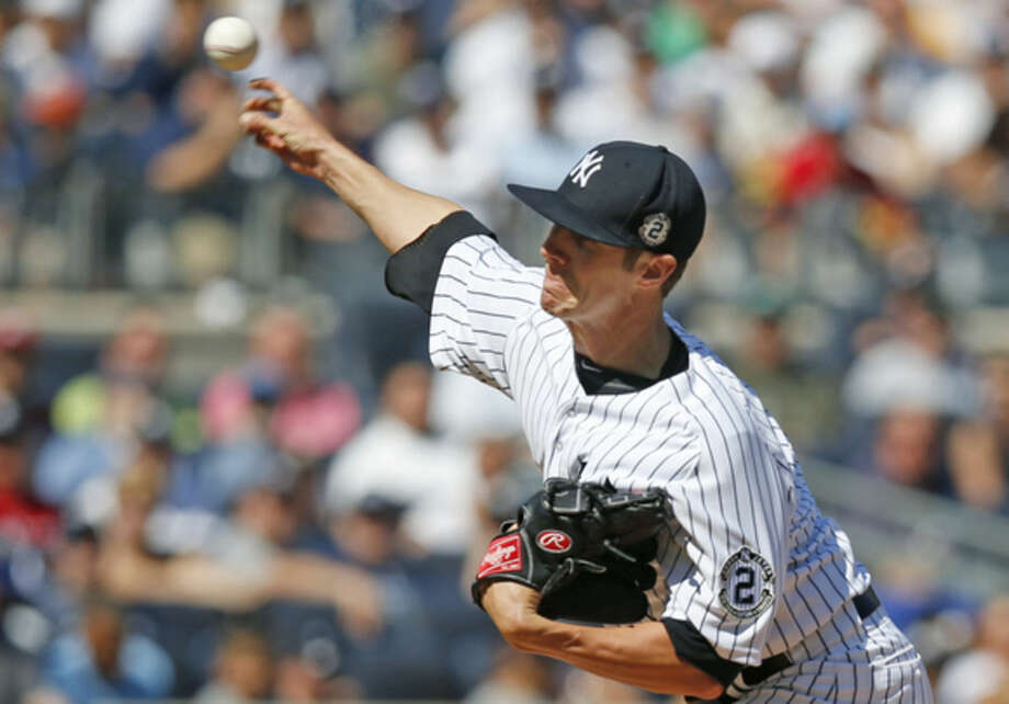 New York Yankees starting pitcher Shane Green delivers in the second inning of a baseball game against the Kansas City Royals at Yankee Stadium in New York, NY, Sunday, Sept. 7, 2014. (AP Photo/Kathy Willens)