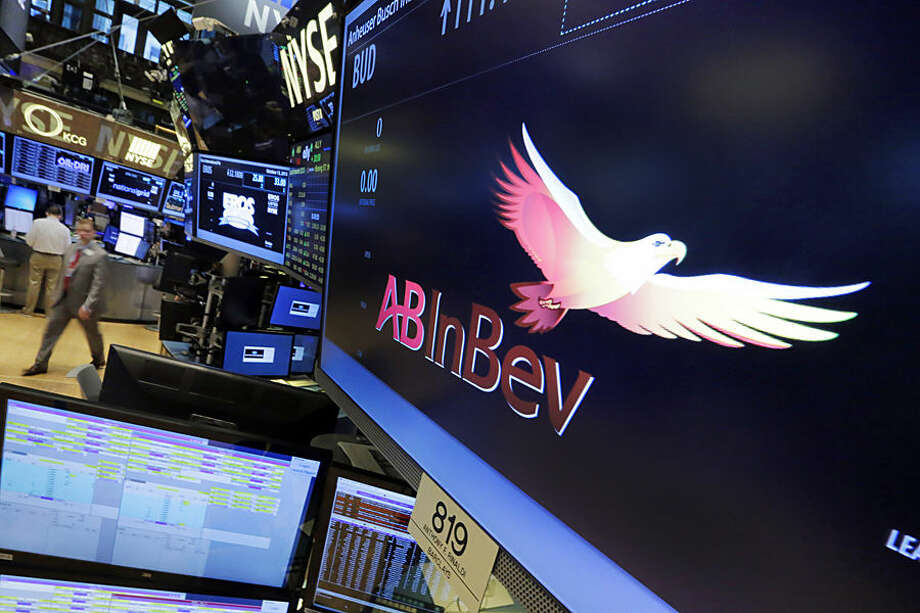 The symbol for ABInBev appears at the post where it trades, on the floor of the New York Stock Exchange, Tuesday, Oct. 13, 2015. The world's top two beer makers agreed Tuesday to join forces to create a company that would control nearly a third of the global market and bring together top U.S. brands Budweiser and Miller Genuine Draft. (AP Photo/Richard Drew)
