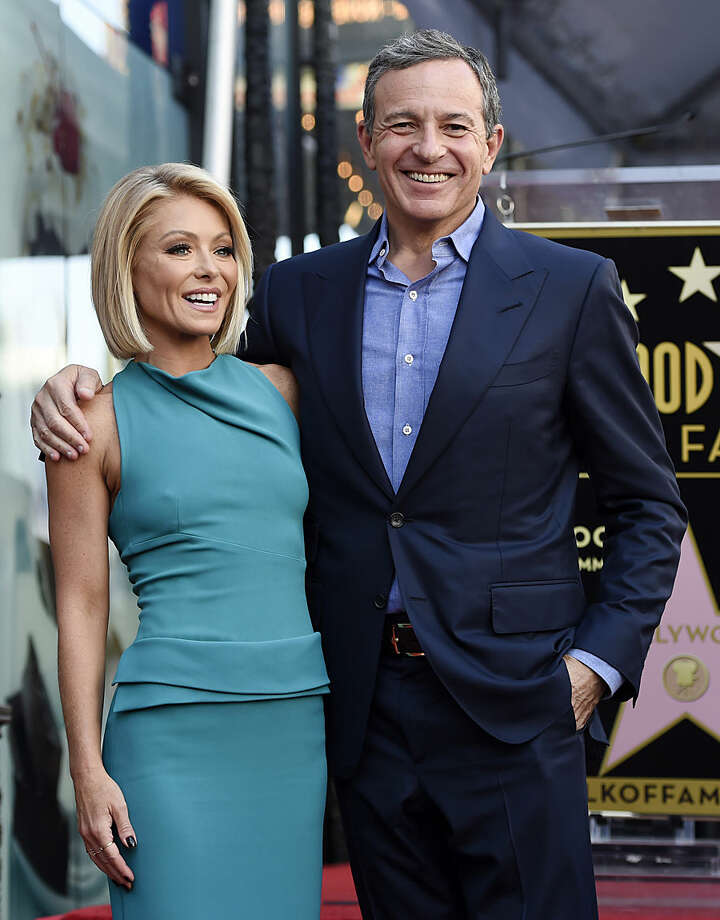 Television personality Kelly Ripa, left, poses with Bob Iger, chairman and CEO of The Walt Disney Company, during a ceremony awarding her with a star on the Hollywood Walk of Fame on Monday, Oct. 12, 2015, in Los Angeles. (Photo by Chris Pizzello/Invision/AP)