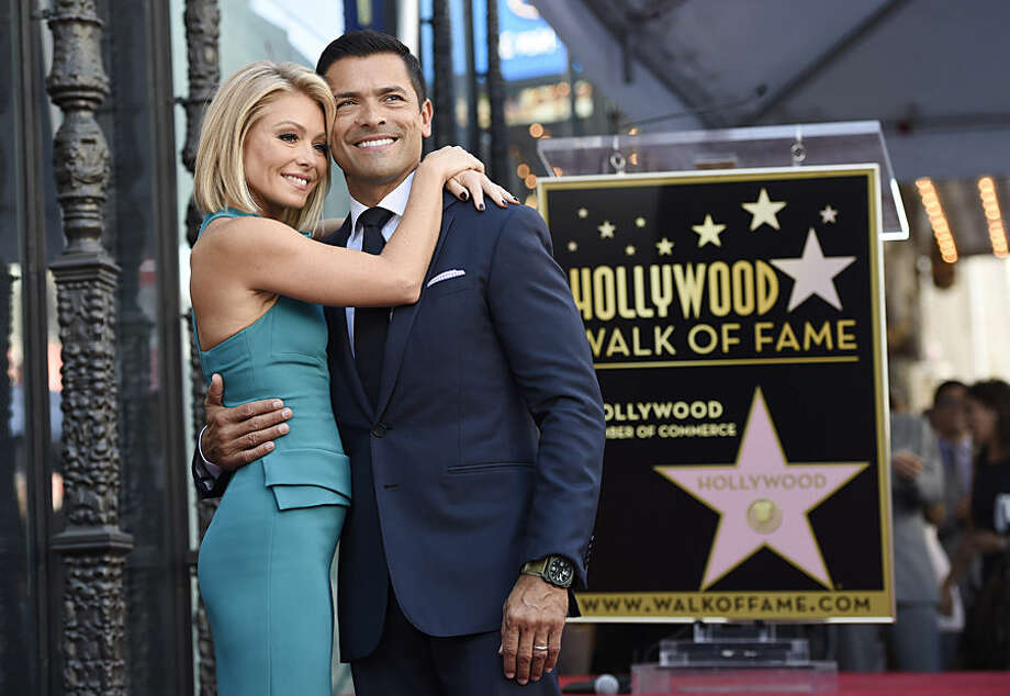 Television personality Kelly Ripa poses with her husband Mark Consuelos after she received a star on the Hollywood Walk of Fame on Monday, Oct. 12, 2015, in Los Angeles. (Photo by Chris Pizzello/Invision/AP)