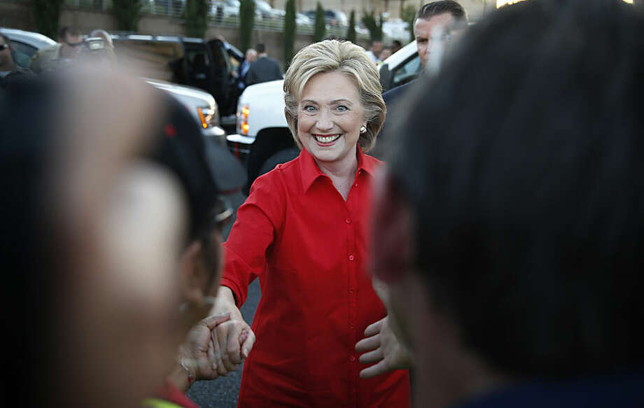 Democratic presidential candidate Hillary Rodham Clinton shakes hands during a rally Monday, Oct. 12, 2015, in Las Vegas. Clinton spoke at a rally held by the Culinary Union to support a union drive at the Trump Hotel. (AP Photo/John Locher)