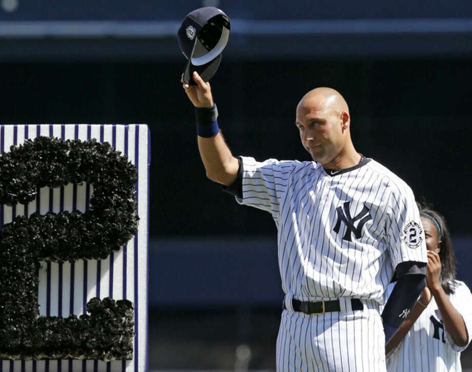 New York Yankees' Derek Jeter (2) tips his cap to fans during a pregame ceremony honoring the Yankees captain, who is retiring at the end of the season, on Derek Jeter Day at Yankee Stadium in New York, Sunday, Sept. 7, 2014. game (AP Photo/Kathy Willens)