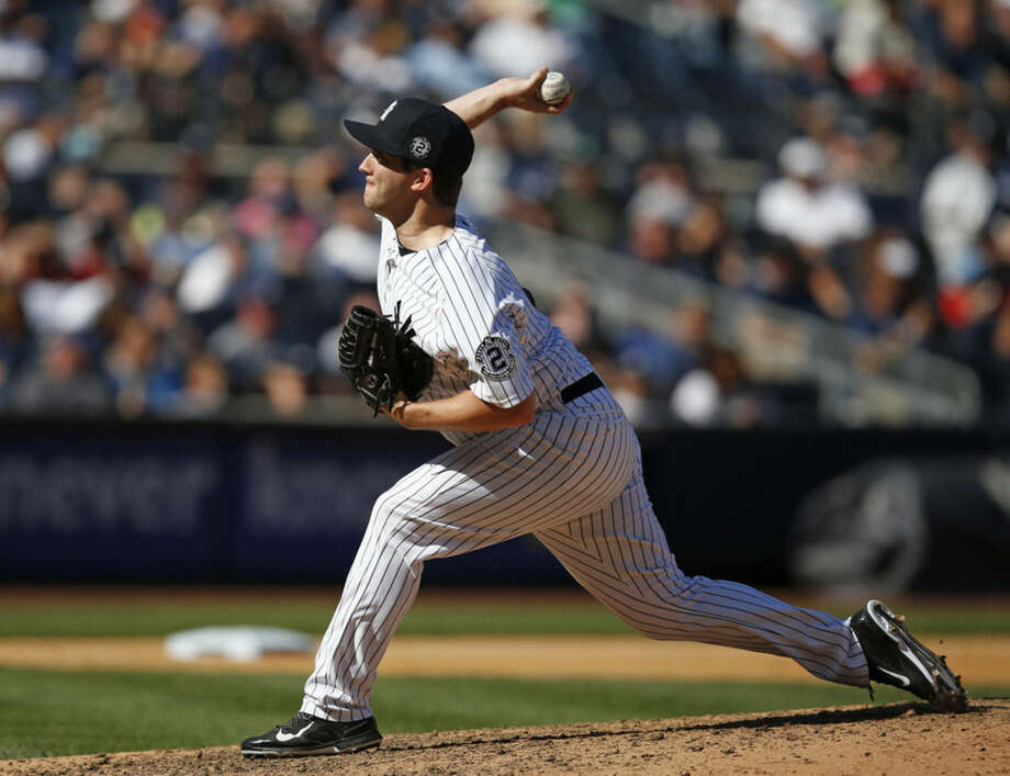 New York Yankees relief pitcher Adam Warren (43) delivers in the sixth inning of a baseball game against the Kansas City Royals at Yankee Stadium in New York, Sunday, Sept. 7, 2014. (AP Photo/Kathy Willens)