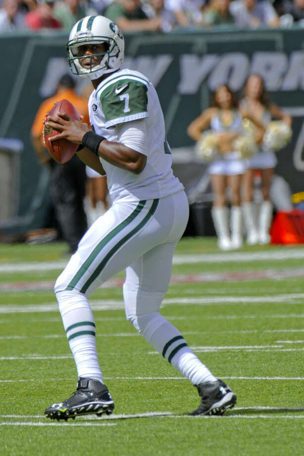 New York Jets' Geno Smith looks to pass during the first half of an NFL football game against the Oakland Raiders Sunday, Sept. 7, 2014, in East Rutherford, N.J. (AP Photo/Bill Kostroun)