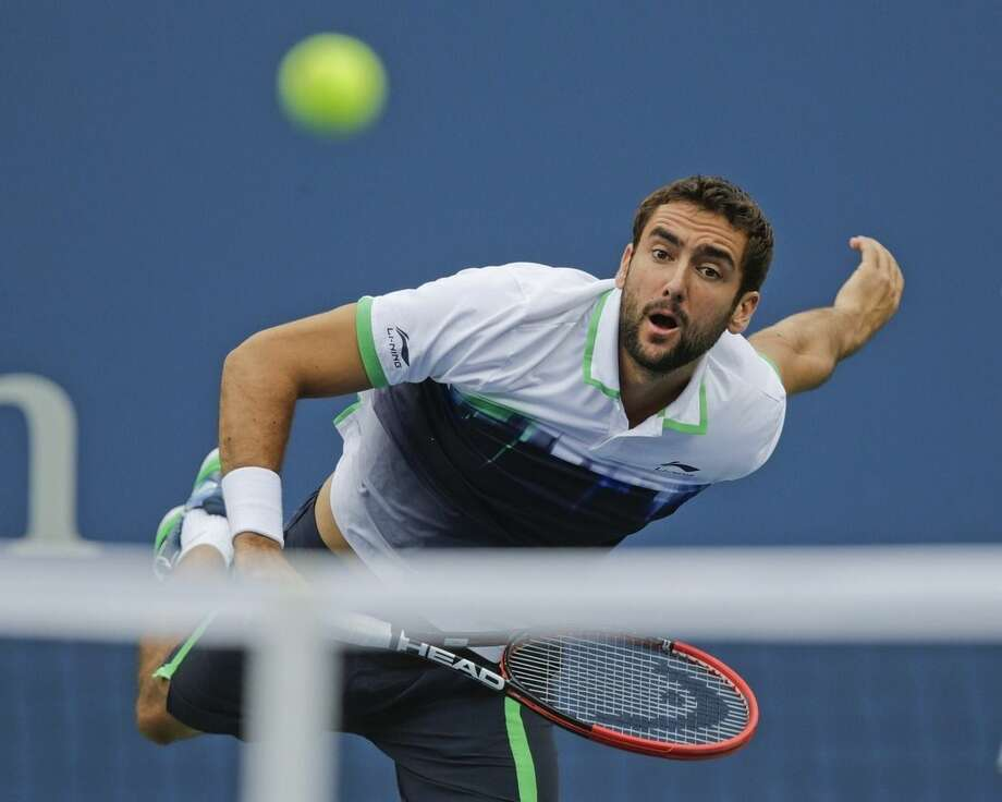 Marin Cilic, of Croatia, serves against Kei Nishikori, of Japan, during the championship match of the 2014 U.S. Open tennis tournament, Monday, Sept. 8, 2014, in New York. (AP Photo/Charles Krupa)