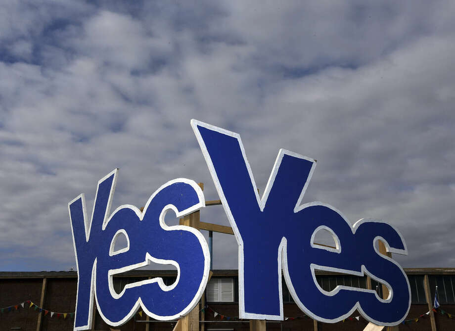 Yes Signs are displayed in Eyemouth, Scotland, Monday, Sept. 8, 2014. Polls predict a very close vote in the upcoming landmark referendum on Scottish independence from Britian on September 18. (AP Photo/Scott Heppell)