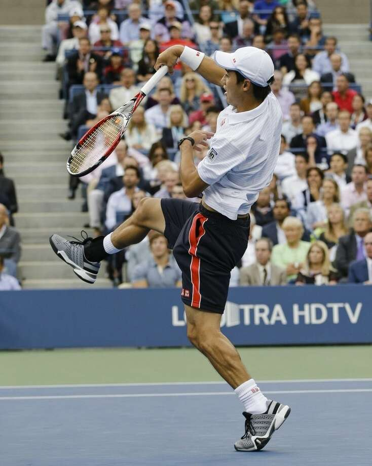 Kei Nishikori, of Japan, returns a shot against Marin Cilic, of Croatia, during the championship match of the 2014 U.S. Open tennis tournament, Monday, Sept. 8, 2014, in New York. (AP Photo/Darron Cummings)