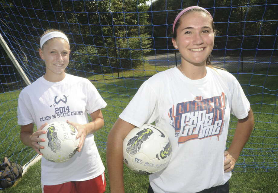 Hour photo/Matthew VinciWilton girls soccer captains Makenna Pearsall, left, and Jayne Maccio. The 2014 Warriors could be without Maccio due to injury, but Pearsall figures to be a big player again this season.