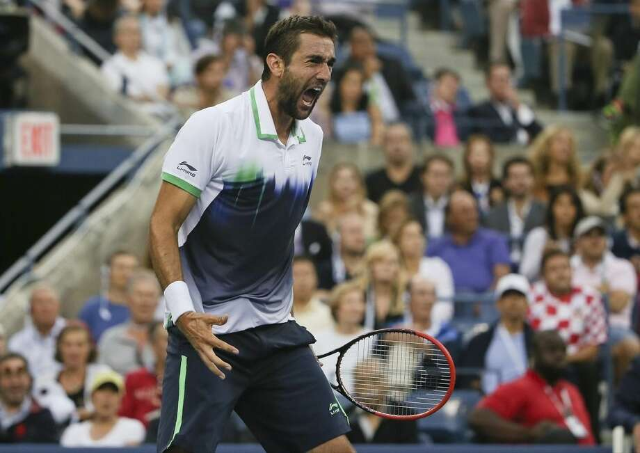 Marin Cilic, of Croatia, reacts after a shot against Kei Nishikori, of Japan, during the championship match of the 2014 U.S. Open tennis tournament, Monday, Sept. 8, 2014, in New York. (AP Photo/Mike Groll)