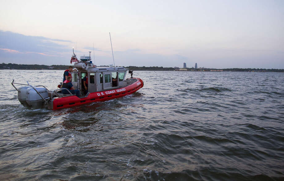 ADVANCE FOR RELEASE TUESDAY, Sept. 9, 2014, AT 12:01 A.M. EDT. - In this photo taken July 12, 2014, personnel on a U.S. Coast Guard response boat out of Station Kings Point, N.Y., head for Glen Island in western Long Island Sound near New Rochelle, N.Y. as they prepare to keep boaters at a safe distance from barge that would soon be the water base of a fireworks display. At private parties on the waters of Long Island Sound, lined by some of the country's most exclusive real estate, hosts setting off elaborate fireworks displays enjoy a little-known benefit. Security is provided, at no expense, by the U.S. Coast Guard. (AP Photo/Craig Ruttle)