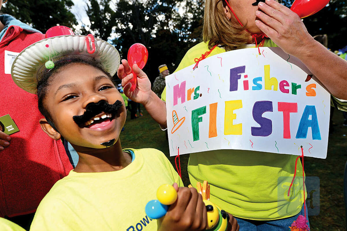Hour photo / Erik Trautmann The Rowayton Elementary School students including Johanie Sainval get pumped up for the PTA's fourth annual Walkathon Friday at the school.