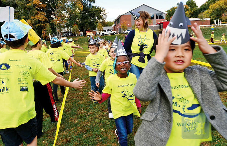 Hour photo / Erik Trautmann The Rowayton Elementary School students and faculty participate in the PTA's fourth annual Walkathon Friday at the school.