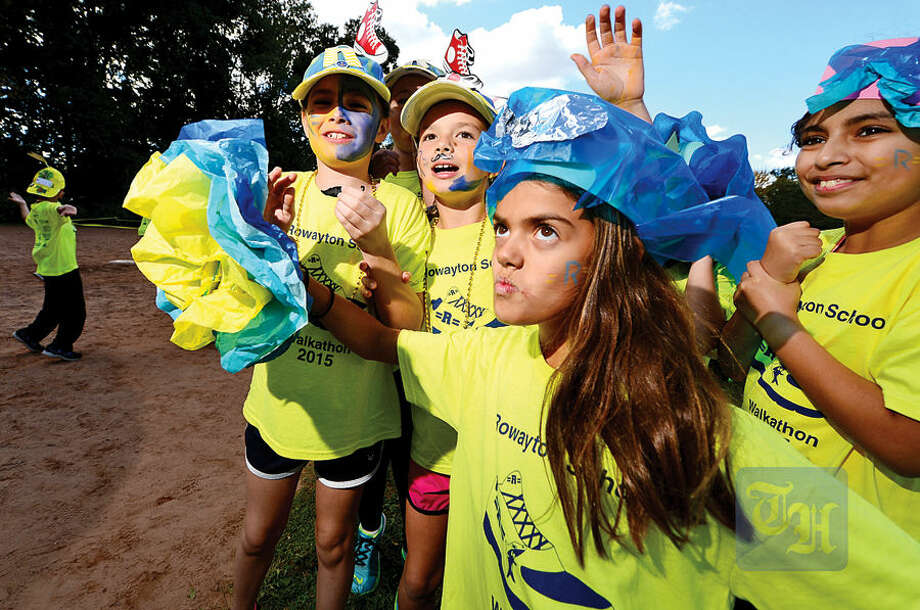 Hour photo / Erik Trautmann The Rowayton Elementary School students including Rose Dunn, center, get pumped up for the PTA's fourth annual Walkathon Friday at the school.