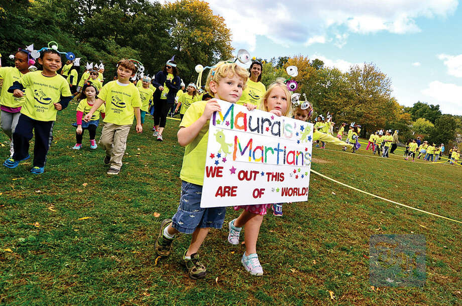 Hour photo / Erik Trautmann The Rowayton Elementary School students including kindergartners Brad Gerster and Lulu Sparkman participate in the PTA's fourth annual Walkathon Friday at the school. The event included students from grades K-5 and raised over $32,000 for school programming.