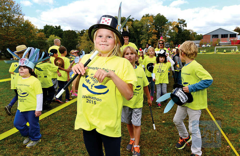 Hour photo / Erik Trautmann Rowayton Elementary School students and faculty including 2nd grader Grayson Farnum participate in the PTA's fourth annual Walkathon Friday at the school. The event included students from grades K-5 and raised over $32,000 for school programming.