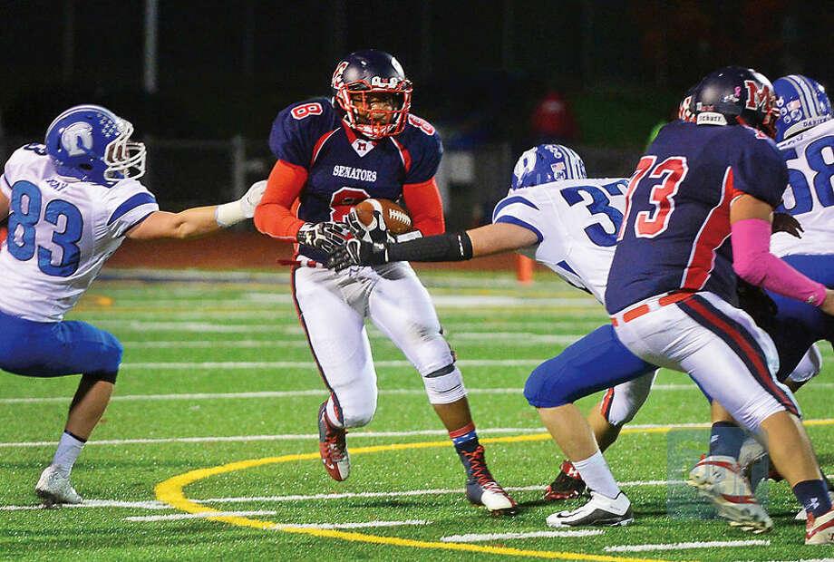 Hour photo / Erik Trautmann Brien McMahon High School's #8 Roshad Russell heads up field in their game against Darien Saturday in Norwalk,