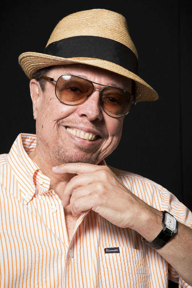 "In this Wednesday, Aug. 27, 2014 photo, Sergio Mendes poses for a portrait in Los Angeles. Mendes, 73, has shaped his five-decade career around such unexpected collaborations, performing across genres with musicians from North and South America. He continues on his latest album, ""Magic,"" available Tuesday, Sept. 9, 2014, which features contributions by John Legend, will.i.am and Janelle Monae, along with Brazilian artists including Milton Nascimiento and Carlinhos Brown. (Photo by Omar Vega/Invision/AP)"