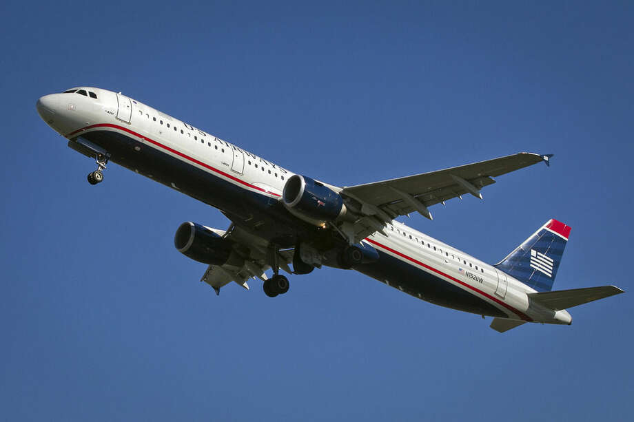 US Airways flight 1939, the final US Airways flight, departs Philadelphia International Airport en route to Charlotte, N.C. on Friday, Oct. 16, 2015. All future flights will fly under the American Airlines banner, following the completion of a merger announced in 2013. (Alejandro A. Alvarez/The Philadelphia Inquirer via AP) PHIX OUT; TV OUT; MAGS OUT; NEWARK OUT; MANDATORY CREDIT