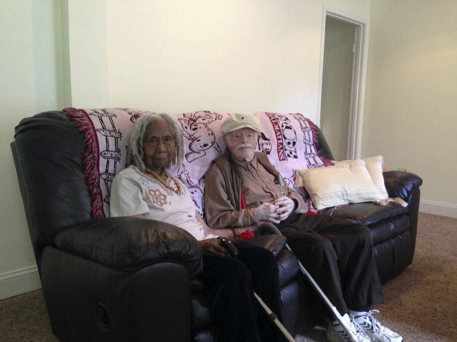 This photo taken Aug. 5, 2014 shows 96-year-old Edith Hill and 95-year-old Eddie Harrison in their home in Annandale, Va. The two have been companions for more than a decade after a Hollywood-style meet-cute _ they struck up a conversation while standing in line for lottery tickets, with one of the tickets turning into a $2,500 winner. They married earlier this year, with a 95-year-old church elder presiding over the ceremony, no less. (AP Photo/Matthew Barakat)