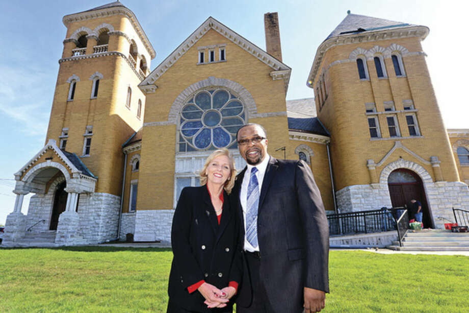 Hour photo / Erik Trautmann Board member Joleen Green and Pastor Reverend Dewitt Stevens stand in front of the Macedonia Church's new renovated building on West Ave. The church plans their grand opening Sunday October 17th.