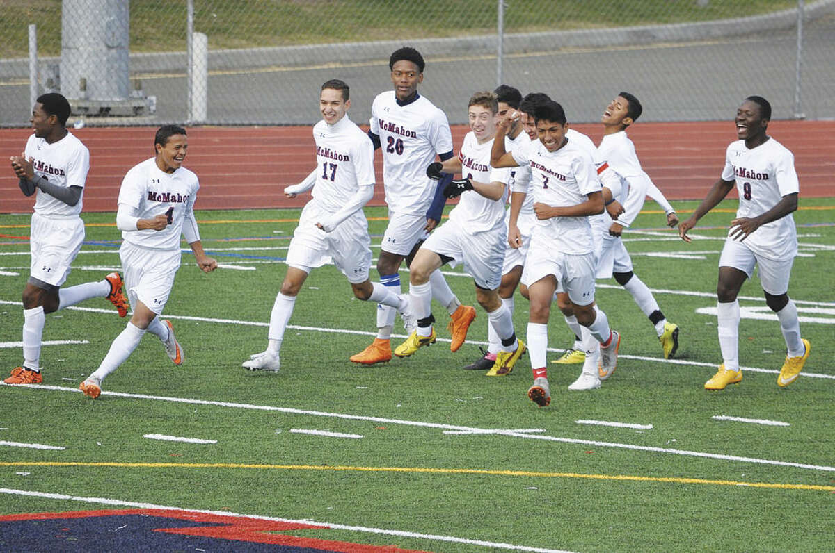 Contributed photo Brien McMahon celebrates after coming back from a two-goal deficit to defeat Trumbull 3-2 on Saturday.