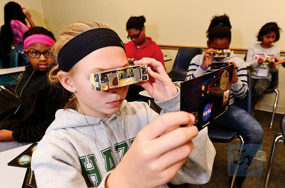 Hour photo / Erik Trautmann Lauren Miller, 12 , looks through a spectrometer during the Saturday Academy Amazing Girls Science: Space Phenomena Space Technology Event at Norwalk Community College. Saturday Academy, Inc. is a non-profit organization that provides scientific and educational enrichment programs designed to create an interest in science and technology.