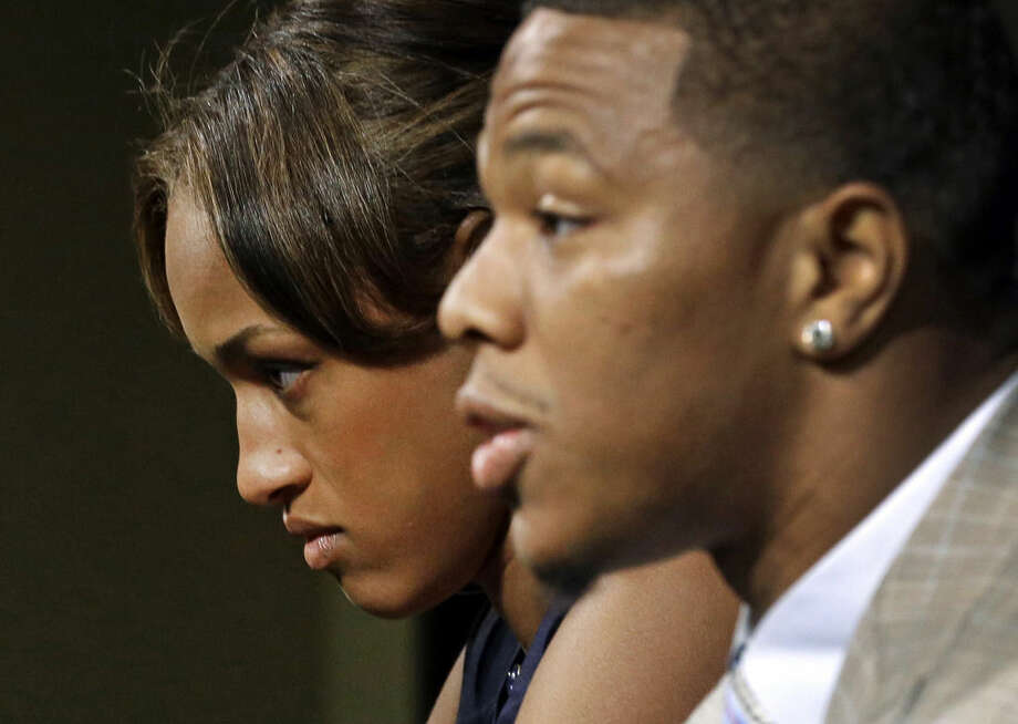 FILE - In this May 23, 2014, file photo, Janay Rice, left, looks on as her husband, Baltimore Ravens running back Ray Rice, speaks to the media during a news conference in Owings Mills, Md. A new video that appears to show Ray Rice striking then-fiance Janay Palmer in an elevator last February has been released on a website. (AP Photo/Patrick Semansky, File)