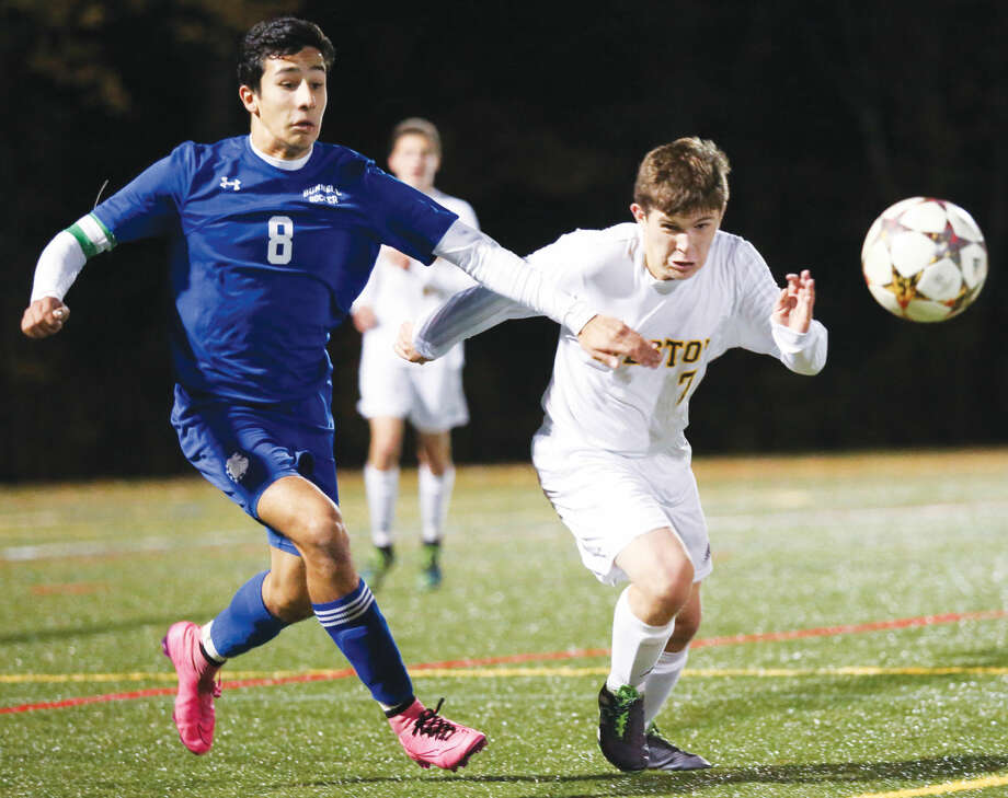 Hour photo/Chris Palermo Weston's Tyler Dyment defends the ball against Bunnell Tuesday night.