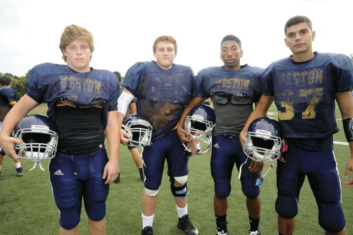 Hour photo/Matthew Vinci Weston High football captains, from left, Peter Lummis, Blake Wertlieb, Samuel Panton and Michael Santa-Maria.