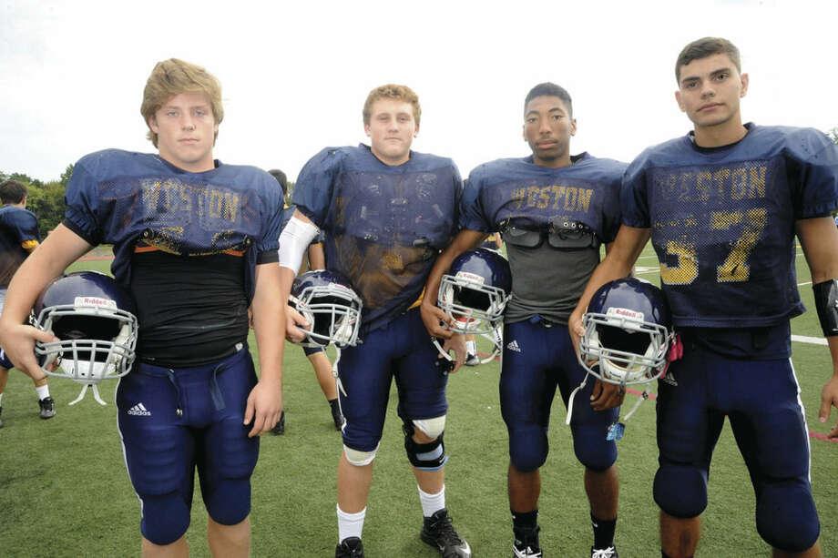 Hour photo/Matthew VinciWeston High football captains, from left, Peter Lummis, Blake Wertlieb, Samuel Panton and Michael Santa-Maria.