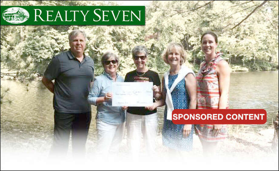 Realty Seven donated $500 to the Friends of Horseshoe Pond