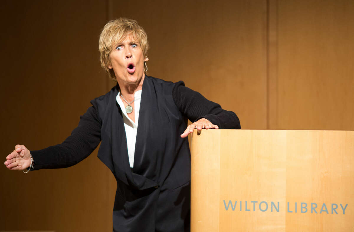 Hour photo/Chris Palermo speaks at the Wilton Library Tuesday evening. Diana Nyad