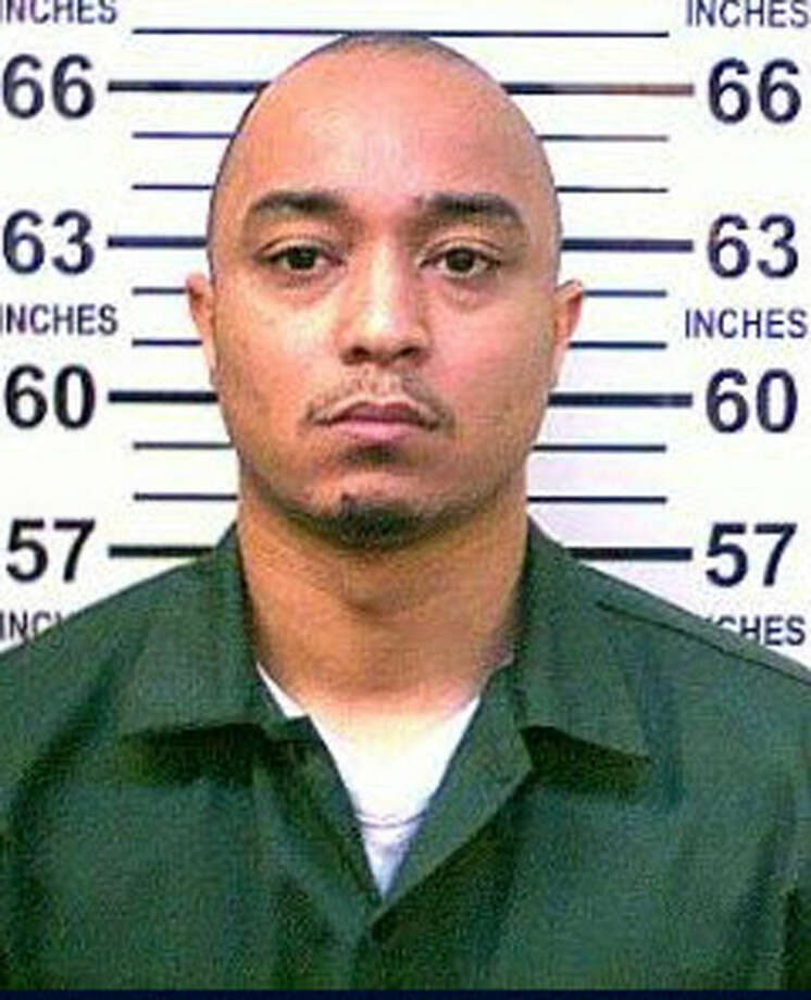 This 2014 photo provided by the New York Department of Corrections shows Tyrone Howard who is in police custody as the suspect in the killing of New York City Police Department Officer Randolph Holder, who was shot dead Tuesday night, Oct. 21, 2015 during an exchange of gunfire in East Harlem. Howard, in police custody Wednesday, had been arrested 20 times for offenses ranging from drug possession to robbery, had been sentenced to state prison twice since 2007 on separate drug possession and sale convictions, state records show. (New York Department of Corrections via AP)