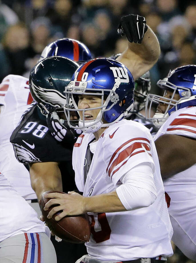 Philadelphia Eagles outside linebacker Connor Barwin (98) applies pressure on New York Giants quarterback Eli Manning, center, during the first half of an NFL football game, Monday, Oct. 19, 2015, in Philadelphia. (AP Photo/Matt Rourke)