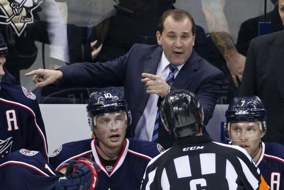FILE - In this Dec. 13, 2014, file photo, Columbus Blue Jackets head coach Todd Richards talks with an official during the third period of an NHL hockey game against the Pittsburgh Penguins in Columbus, Ohio. After an 0-7 start, the Blue jackets have fired coach Todd Richards and replaced him with John Tortorella, Wednesday, Oct. 21, 2015.(AP Photo/Gene J. Puskar)