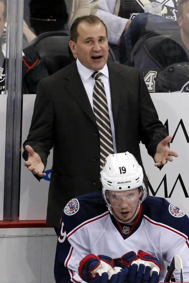FILE - In this April 26, 2014, file photo, Columbus Blue Jackets head coach Todd Richards talks with an official during a first-round NHL playoff hockey game against the Pittsburgh Penguins in Pittsburgh. After an 0-7 start, the Blue jackets have fired coach Todd Richards and replaced him with John Tortorella, Wednesday, Oct. 21, 2015. (AP Photo/Gene J. Puskar, File)
