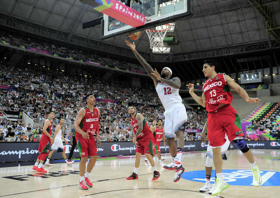 DeMarcus Cousins of the U.S, second right, vies for the ball over Mexico's Orlando Mendez, right, during Basketball World Cup Round of 16 match between United States and Mexico at the Palau Sant Jordi in Barcelona, Spain, Saturday, Sept. 6, 2014. The 2014 Basketball World Cup competition will take place in various cities in Spain from Aug. 30 through to Sept. 14. (AP Photo/Manu Fernandez)