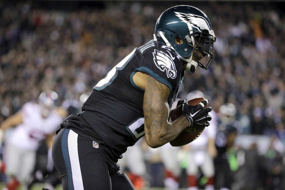 Philadelphia Eagles cornerback Nolan Carroll runs with the ball after intercepting a pass from New York Giants quarterback Eli Manning during the first half of an NFL football game, Monday, Oct. 19, 2015, in Philadelphia. (AP Photo/Matt Rourke)