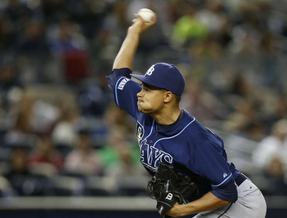 Tampa Bay Rays starting pitcher Chris Archer delivers in the fourth inning against the New York Yankees in a baseball game at Yankee Stadium in New York, Tuesday, Sept. 9, 2014. (AP Photo/Kathy Willens)