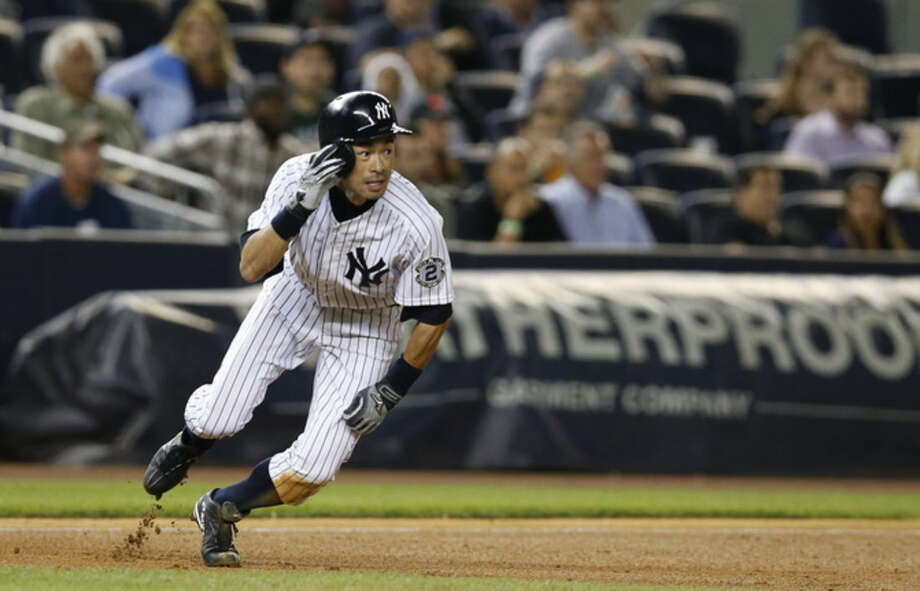 New York Yankees' Ichiro Suzuki reacts before he was picked off between second and third in the seventh inning of a baseball game against the Tampa Bay Rays at Yankee Stadium in New York, Tuesday, Sept. 9, 2014. (AP Photo/Kathy Willens)