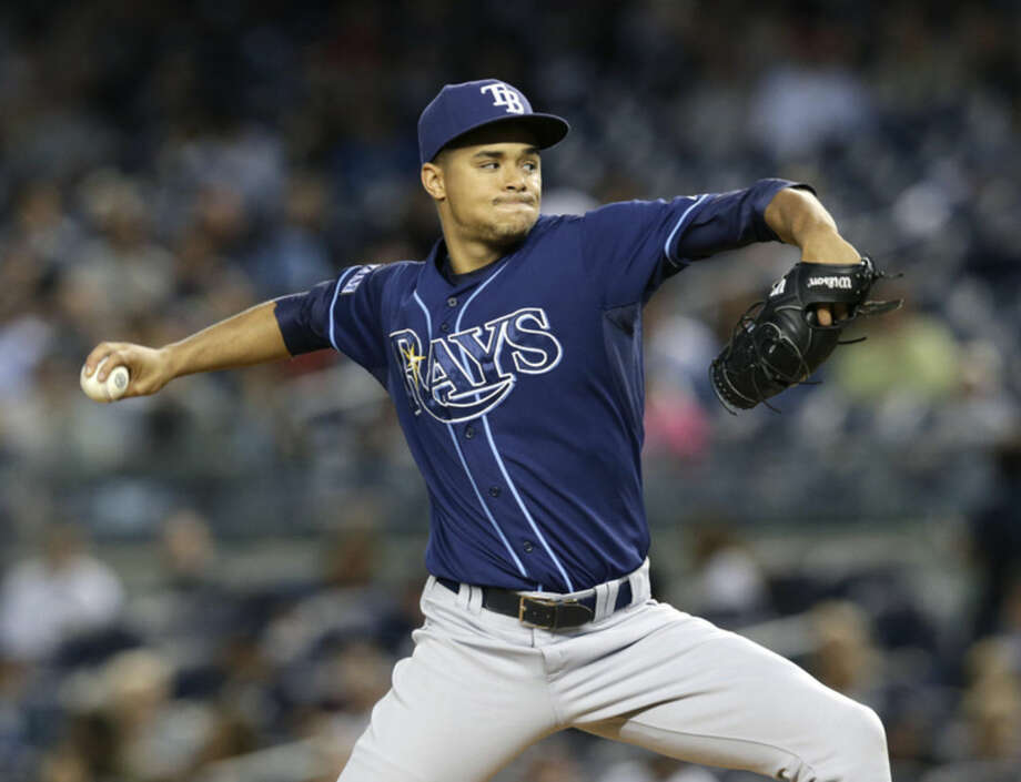Tampa Bay Rays starting pitcher Chris Archer delivers against the New York Yankees in the first inning of a baseball game at Yankee Stadium in New York, Tuesday, Sept. 9, 2014. (AP Photo/Kathy Willens)