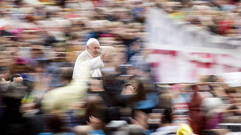 "Pope Francis waves from his popemobile as he arrives for his weekly general audience in St. Peter's Square, at the Vatican, Wednesday, Oct. 21, 2015. The Vatican is denying a report in an Italian newspaper that Pope Francis has a small, curable brain tumor. The Vatican spokesman, the Rev. Federico Lombardi, said the report Wednesday in the National Daily was ""unfounded and seriously irresponsible and not worthy of attention."" (AP Photo/Andrew Medichini)"