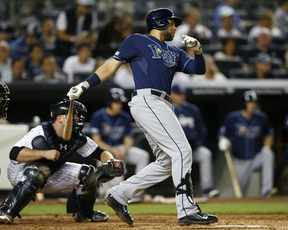 Tampa Bay Rays James Loney follows through on a third-inning RBI single off New York Yankees starting pitcher Hiroki Kuroda in a baseball game at Yankee Stadium in New York, Tuesday, Sept. 9, 2014. Loney also hit a second-inning solo home run off Kuroda. (AP Photo/Kathy Willens)