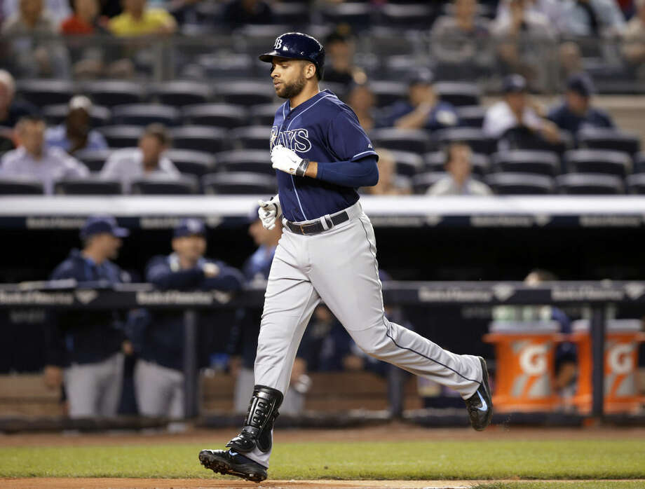 Tampa Bay Rays James Loney runs the bases after hitting a second-inning solo home run off New York Yankees starting pitcher Hiroki Kuroda in a baseball game at Yankee Stadium in New York, Tuesday, Sept. 9, 2014. (AP Photo/Kathy Willens)