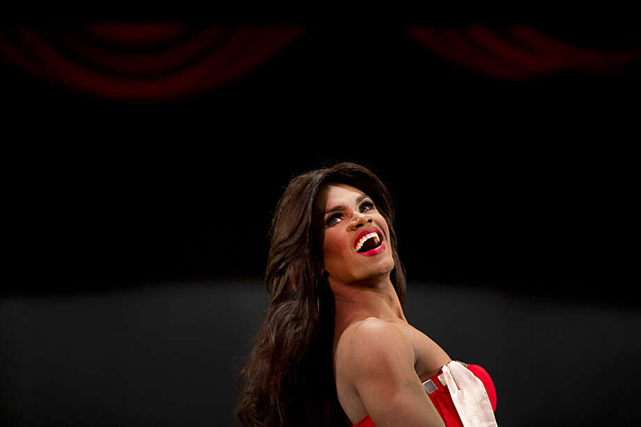 In this Oct. 18, 2015 photo, contestant Alfredo Lopez, Miss Gay Miranda, competes at the ninth annual Miss Gay Venezuela beauty pageant in Caracas, Venezuela. Some of the contestant's evening gowns are from Venezuela's top designers who also work with the Miss Venezuela organization. (AP Photo/Ariana Cubillos)