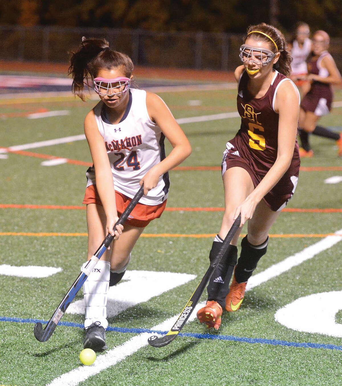 Hour photo/Alex von Kleydorff Brien McMahon's Zoe Bale battles through a St. Joseph defender on Wednesday night.